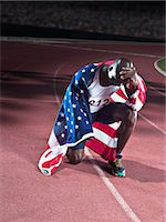 race track (people) - Track and field athlete wrapped in American flag on track Stock Photo - Premium Royalty-Freenull, Code: 6113-07588797