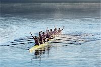 sport rowing teamwork - Rowing team celebrating in scull on lake Stock Photo - Premium Royalty-Freenull, Code: 6113-07588802