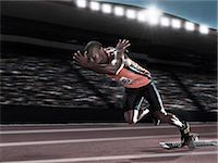 race track (people) - Runner racing on track Stock Photo - Premium Royalty-Freenull, Code: 6113-07588817