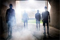 fog (weather) - Silhouette of soccer teams facing field Stock Photo - Premium Royalty-Freenull, Code: 6113-07588836