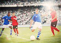 Soccer player kicking ball on field Stock Photo - Premium Royalty-Freenull, Code: 6113-07588842