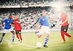 Soccer player kicking ball on field Stock Photo - Premium Royalty-Freenull, Code: 6113-07588842