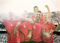 football team - Soccer team celebrating on field Stock Photo - Premium Royalty-Freenull, Code: 6113-07588845
