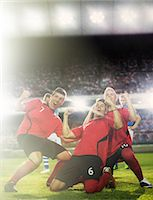 footballeur - Soccer team celebrating on field Stock Photo - Premium Royalty-Freenull, Code: 6113-07588856