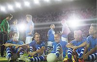 football team - Soccer team relaxing on field Stock Photo - Premium Royalty-Freenull, Code: 6113-07588857