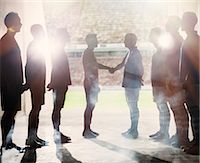 football team - Silhouette of soccer teams shaking hands Stock Photo - Premium Royalty-Freenull, Code: 6113-07588858