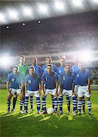 football team - Soccer team posing on field Stock Photo - Premium Royalty-Freenull, Code: 6113-07588859