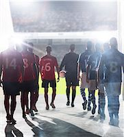football team - Silhouette of soccer players walking to field Stock Photo - Premium Royalty-Freenull, Code: 6113-07588862