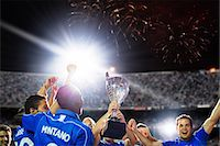 footballeur - Soccer team celebrating with trophy on field Stock Photo - Premium Royalty-Freenull, Code: 6113-07588863