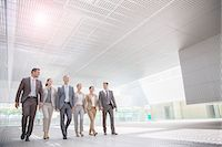 Business people walking in modern courtyard Stock Photo - Premium Royalty-Freenull, Code: 6113-07588900
