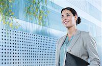 Confident businesswoman outdoors Stock Photo - Premium Royalty-Freenull, Code: 6113-07588904