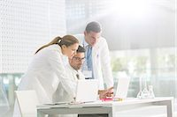 science & technology - Doctors using laptop in laboratory Stock Photo - Premium Royalty-Freenull, Code: 6113-07589001