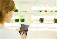 Scientist using digital tablet in laboratory Stock Photo - Premium Royalty-Freenull, Code: 6113-07589142
