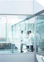 Doctors and administrator in office corridor Stock Photo - Premium Royalty-Freenull, Code: 6113-07589288
