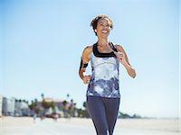 fitness   mature woman - Woman running on beach Stock Photo - Premium Royalty-Freenull, Code: 6113-07589325