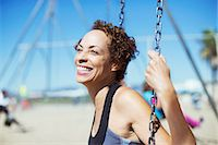 Enthusiastic woman swinging Stock Photo - Premium Royalty-Freenull, Code: 6113-07589364