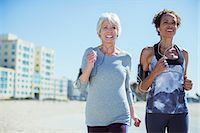 Senior women jogging outdoors Stock Photo - Premium Royalty-Freenull, Code: 6113-07589372