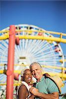 Portrait of happy senior couple hugging at amusement park Stock Photo - Premium Royalty-Freenull, Code: 6113-07589436