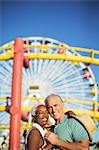 Portrait of happy senior couple hugging at amusement park Stock Photo - Premium Royalty-Freenull, Code: 6113-07589436
