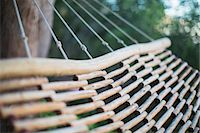 Wooden hammock Stock Photo - Premium Royalty-Freenull, Code: 6113-07589738