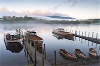 Boats moored on Derwentwater near Friar's Crag in autumn, Keswick, Lake District National Park, Cumbria, England, United Kingdom, Europe Stock Photo - Premium Rights-Managednull, Code: 841-07590320