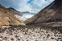 Little sand mounds on a glacier field on Mutnovsky volcano, Kamchatka, Russia, Eurasia Stock Photo - Premium Rights-Managednull, Code: 841-07590425