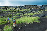 Tourists walking through the lava landscape