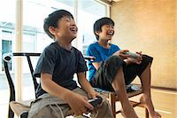 Japanese kids playing a video game Stock Photo - Premium Royalty-Freenull, Code: 613-07593311