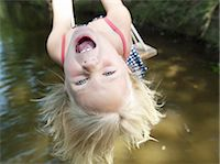 swing (sports) - Girl on swing making silly face Stock Photo - Premium Royalty-Freenull, Code: 613-07593403