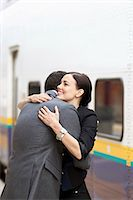 Couple embracing at train station Stock Photo - Premium Royalty-Freenull, Code: 613-07593535