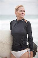 50's women surfer day at the beach Stock Photo - Premium Royalty-Freenull, Code: 6106-07593728