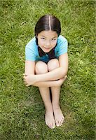 preteen girl pigtails - Young girl sitting on the grass, portrait Stock Photo - Premium Royalty-Freenull, Code: 6106-07594820