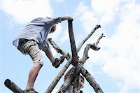 Boys climbing branch structure Stock Photo - Premium Royalty-Freenull, Code: 649-07596282