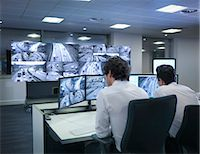 Operators with screens in traffic control room Stock Photo - Premium Royalty-Freenull, Code: 649-07596324