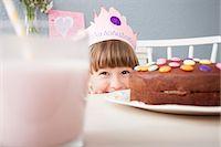 Girl hiding behind cake Stock Photo - Premium Royalty-Freenull, Code: 649-07596602