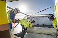 Emergency Response Team workers erecting tent control centre Stock Photo - Premium Royalty-Freenull, Code: 649-07596617