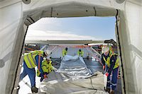 Emergency Response Team workers erecting tent control centre Stock Photo - Premium Royalty-Freenull, Code: 649-07596618