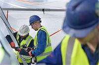 Emergency Response Team workers erecting tent control centre Stock Photo - Premium Royalty-Freenull, Code: 649-07596622