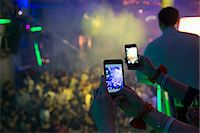 Women taking photograph in nightclub with cellular phone Stock Photo - Premium Royalty-Freenull, Code: 649-07596630