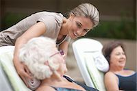 Senior women relaxing on loungers in retirement villa garden Stock Photo - Premium Royalty-Freenull, Code: 649-07596679