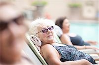 Senior women on sun loungers in retirement villa garden Stock Photo - Premium Royalty-Free, Artist: Cultura RM, Code: 649-07596680