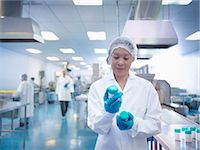 Worker inspecting packaging in pharmaceutical factory Stock Photo - Premium Royalty-Freenull, Code: 649-07596686