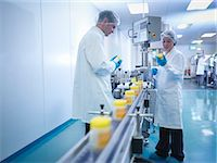 Workers inspecting packaging in pharmaceutical factory Stock Photo - Premium Royalty-Freenull, Code: 649-07596688