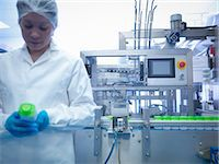 pharmaceutical plant - Worker inspecting products on production line in pharmaceutical factory Stock Photo - Premium Royalty-Freenull, Code: 649-07596690