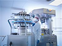 pharmaceutical plant - Engineer performing maintenance on tablet manufacturing machine in pharmaceutical factory Stock Photo - Premium Royalty-Freenull, Code: 649-07596694