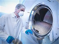 pharmaceutical plant - Worker using tablet coating machine in pharmaceutical factory Stock Photo - Premium Royalty-Freenull, Code: 649-07596695