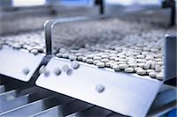 pharmaceutical plant - Close up of tablets in packing machine in pharmaceutical factory Stock Photo - Premium Royalty-Freenull, Code: 649-07596707