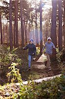 Twin brothers racing through forest Stock Photo - Premium Royalty-Freenull, Code: 649-07596710