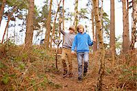 Twin brothers strolling in woods Stock Photo - Premium Royalty-Freenull, Code: 649-07596730