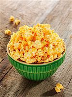 Bowl of Cheese Flavored Popcorn Stock Photo - Premium Royalty-Freenull, Code: 659-07597438